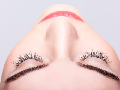 Closeup shot of female closed eye and brows with day makeup